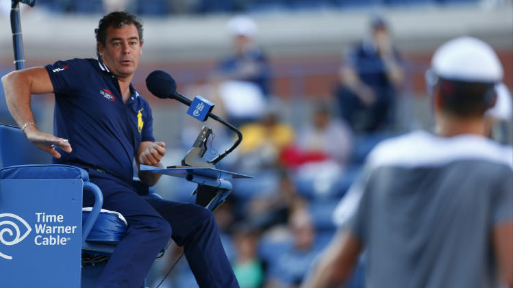 The chair umpire explains a decision to Tomas Berdych, of the Czech Republic, during a second round match against Martin Klizan of Slovakia during the 2014 U.S. Open tennis tournament, Friday, Aug. 29, 2014, in New York. (AP Photo/Matt Rourke)
