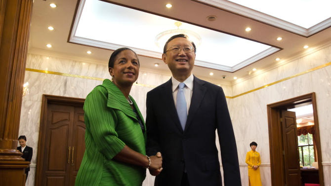 U.S. National Security Advisor Susan Rice, left, shakes hands with Chinese State Councilor Yang Jiechi at the Diaoyutai State Guesthouse in Beijing, China, Friday, Aug. 28, 2015. (AP Photo/Ng Han Guan, Pool)