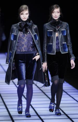 Models wear creations part of the Emporio Armani women's Fall-Winter 2012-2013 collection that was presented in Milan, Italy, Saturday, Feb. 25, 2012.(AP Photo/Luca Bruno)
