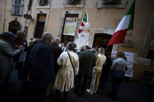 Democratic Party supporters queue in front of a party polling station to choose between five candidates in the primary election in Rome. The centre-left in recession-hit Italy voted Sunday to choose the Democratic Party candidate who will run for prime minister in a general election next year that it is widely expected to win.