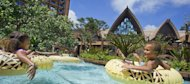In this undated image released by Disney Destinations, people enjoy the pool at Aulani, a new Disney Resort & Spa in Hawaii. Aulani, with 840 units is located an hour from Waikiki on Oahu, showcases Hawaiian culture and its natural beauty. (AP Photo/Disney Destinations)