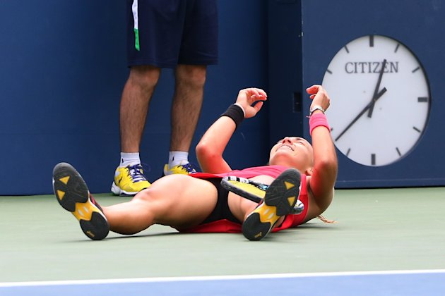 Aug 30, 2014; New York, NY, USA; Aleksandra Krunic (SRB) falls to the ground after defeating Petra Kvitova (CZE) at Armstrong Stadium on day six of th...