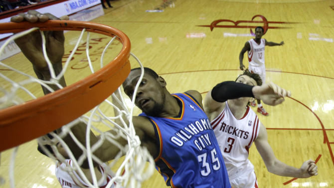 Oklahoma City Thunder's Kevin Durant (35) dunks the ball as Houston Rockets' Omer Asik (3) defends during the second half of Game 4 in a first-round NBA basketball playoff series Monday, April 29, 2013, in Houston. The Rockets beat the Thunder 105-103. (AP Photo/David J. Phillip)