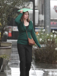 Carly Narlesky uses a folder to protect herself from the rain in Sacramento, Calif, Monday, Oct. 22, 2012. The first storm of the season swept through Northern California bringing rain to the lower elevations and snow in the mountains. (AP Photo/Rich Pedroncelli)