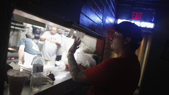 Gaby Rivera, an assistant manager, checks orders at Tobacco Road, the oldest bar in Miami