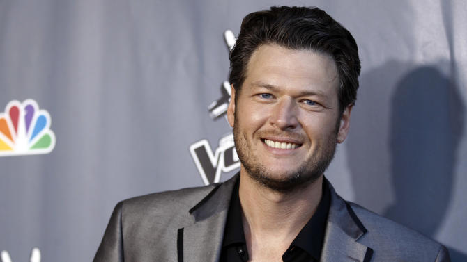 """Musician Blake Shelton poses for photographers after finale of """"The Voice"""" in Burbank, Calif., Wednesday, June 29, 2011. Javier Colon was named the winner of the show during the finale. (AP Photo/Matt Sayles)"""