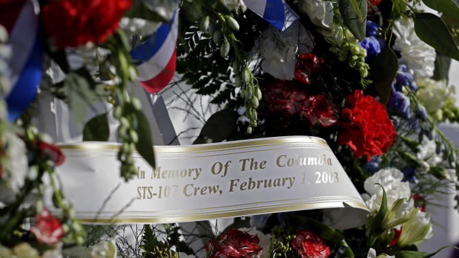 A wreath placed at the Space Mirror Memorial is seen during a remembrance ceremony on the 10th anniversary of the loss of space shuttle Columbia crew at the Kennedy Space Center Visitor Complex,  Friday, Feb. 1, 2013, in Cape Canaveral, Fla. Ten years ago, the space shuttle Columbia and its seven astronauts were lost. They were returning from a 16-day mission and were just 16 minutes from home when the shuttle disintegrated on Feb. 1, 2003. (AP Photo/John Raoux)