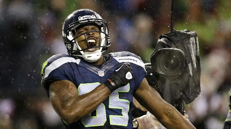 Seattle Seahawks' Anthony McCoy reacts after scoring against the San Francisco 49ers late in the first half of an NFL football game, Sunday, Dec. 23, 2012, in Seattle. (AP Photo/Elaine Thompson)