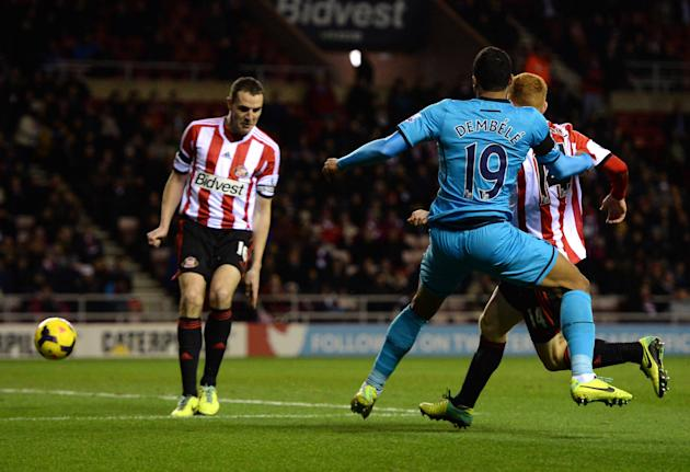 Tottenham Hotspur's Moussa Dembele kicks the ball which was deflected into goal by Sunderland's John O'Shea during their English Premier League soccer match at the Stadium of Light in Sund