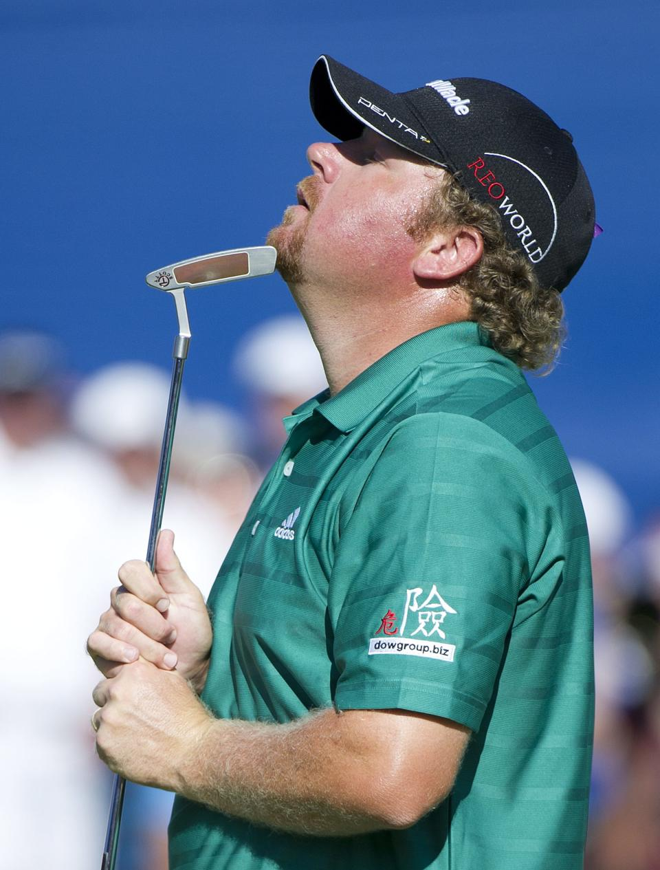 William McGirt reacts with his putter after missing a put to force a play-off on 18 during final round play at the 2012 Canadian Open at the Hamilton Golf and County Club in Ancaster, Ontario, on Sunday, July 29, 2012. (AP Photo/The Canadian Press, Nathan Denette)