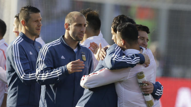 Chile's Alexis Sanchez, right, hugs Argentina's Lionel Messi  during the Copa America final soccer match at the National Stadium in Santiago, Chile, Saturday, July 4, 2015. (AP Photo/Ricardo Mazalan)