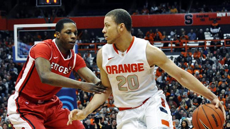 Syracuse's Brandon Triche (20) drives against Rutgers' Mike Poole during the second half of an NCAA college basketball game in Syracuse, N.Y., Wednesday, Jan. 2, 2013. Syracuse won 78-53. (AP Photo/Kevin Rivoli)