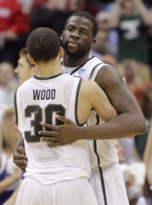Michigan State's Draymond Green, right, celebrates with Brandon Wood after an NCAA college basketball tournament third-round game Sunday, March 18, 2012, in Columbus, Ohio. Michigan State defeated Saint Louis 65-61. (AP Photo/Jay LaPrete)
