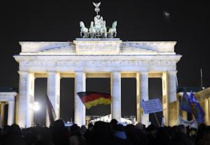 People with German national flags attend a BEGIDA rally …