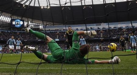 Manchester City's Hart dives to save a penalty from Chelsea's Lampard during their English Premier League soccer match at The Etihad Stadium in Manchester