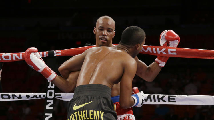 Rances Barthelemy, foreground, keeps Argenis Mendez on the ropes on Friday, July 11, 2014, during a boxing match begun late Thursday in Miami. Barthelemy won a unanimous decision over Mendez and captured the International Boxing Federation junior-lightweight title. (AP Photo/Wilfredo Lee)