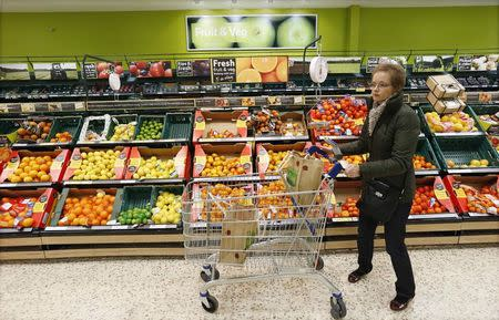 A file photograph shows a customer shopping at a Tesco shop in Bishop's Stortford, southern England