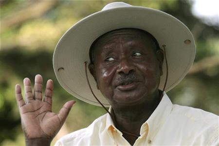 Uganda's President Museveni reacts during a news conference at the State House compound in the capital Kampala