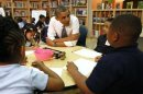 U.S. President Barack Obama talks with pre-kindergarten students in Baltimore