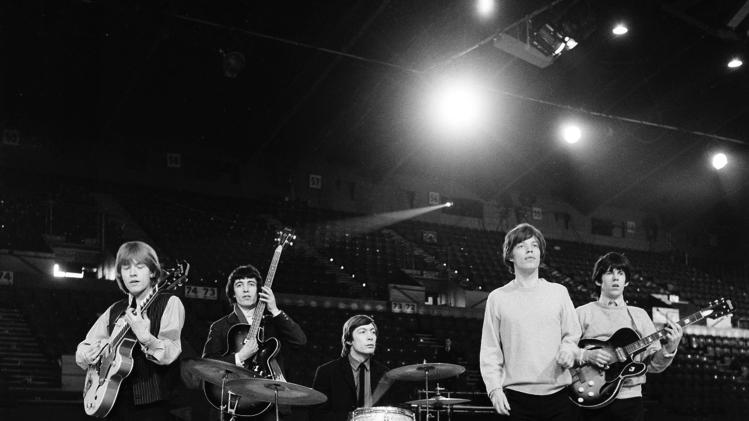 "EMBARGO UNTIL 5 AM FEB. 27, 2013 - FILE - This April 8, 1964 file photo shows The Rolling Stones during a rehearsal at an unknown location. The British band members, from left, are, Brian Jones, guitar; Bill Wyman, bass; Charlie Watts, drums; Mick Jagger, vocals; and Keith Richards, guitar. The Cleveland-based The Rock and Roll Hall of Fame Museum will open ""Rolling Stones: 50 Years of Satisfaction,"" an exclusive exhibit celebrating the archetypal rock band, on May 24, 2013. (AP Photo, File)"