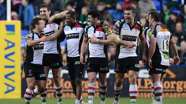 Harlequins' players celebrate after being awaeded a late try to win the match
