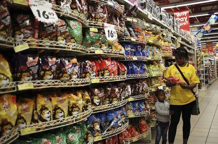 A customer shops for food items with a child, at a Shoprite store in Johannesburg