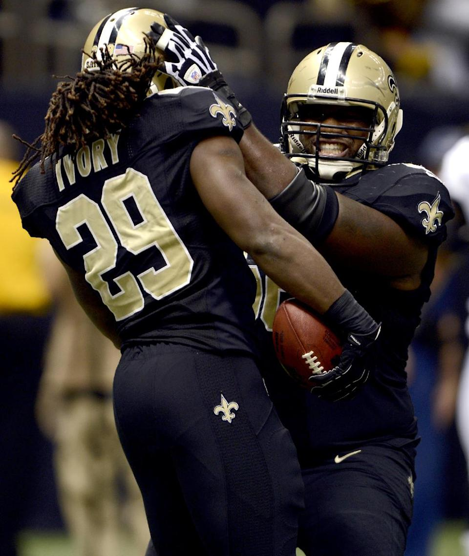 New Orleans Saints running back Chris Ivory (29) celebrates his touchdown with guard Ben Grubbs during the first half an NFL football game against the Philadelphia Eagles at Mercedes-Benz Superdome in New Orleans, Monday, Nov. 5, 2012. (AP Photo/Bill Feig)