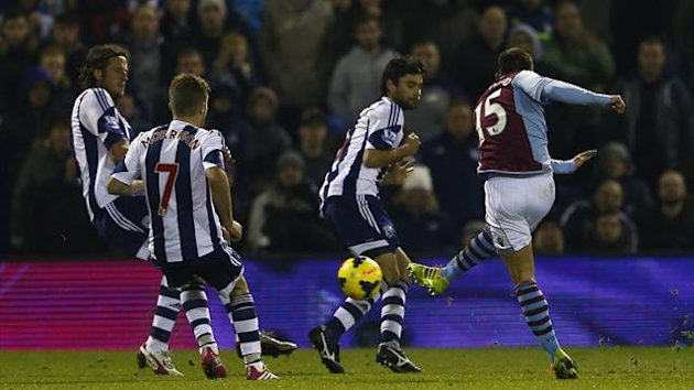 Aston Villa's Ashley Westwood (R) shoots and scores a goal against West Bromwich Albion (Reuters)