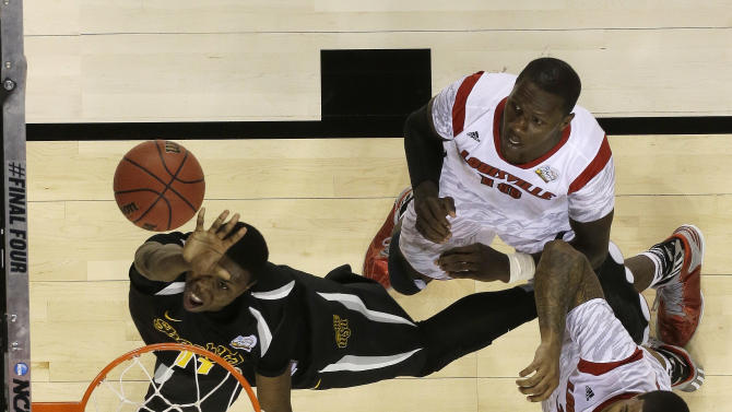 Wichita State's Cleanthony Early (11) shoots against a Louisville defense during the second half of the NCAA Final Four tournament college basketball semifinal game Saturday, April 6, 2013, in Atlanta. (AP Photo/Charlie Neibergall)