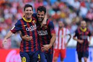 Barcelona's Lionel Messi (left) celebrates with Cesc Fabregas at the Juegos Mediterraneos stadium in Almeria, Spain on September 28, 2013