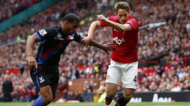 Crystal Palace's Adrian Mariappa (L) challenges Manchester United's Adnan Januzaj during their English Premier League match at Old Trafford