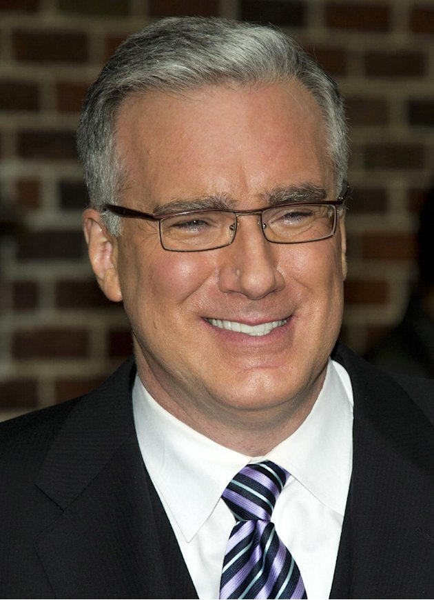 FILE - In this Oct. 24, 2011 file photo, political pundit Keith Olbermann leaves a taping of the &quot;Late Show with David Letterman,&quot; in New York. Current TV says it has ejected Keith Olbermann from its talk-show lineup after less than a year. The network announced late Friday afternoon that &quot;Countdown,&quot; the show Olbermann has hosted since last June, was to be replaced with a show hosted by former New York Gov. Eliot Spitzer, beginning Friday night