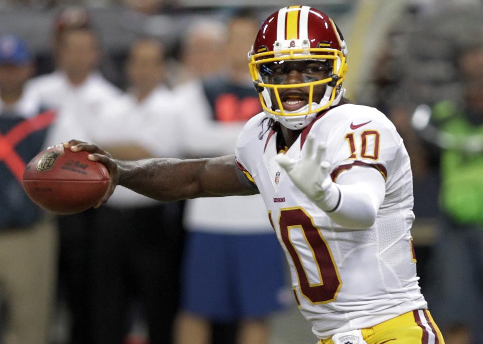 Washington Redskins quarterback Robert Griffin III throws during the first quarter of an NFL football game against the St. Louis Rams, Sunday, Sept. 16, 2012, in St. Louis. (AP Photo/Seth Perlman)
