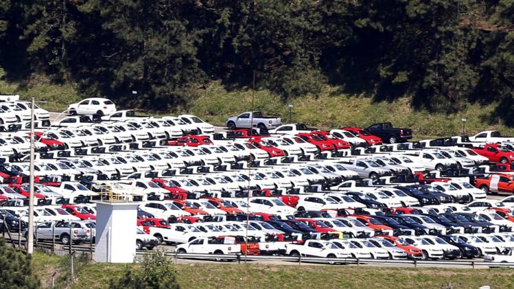 New cars are parked at a stock area of the Volkswagen German automaker plant in Sao Bernardo do Campo