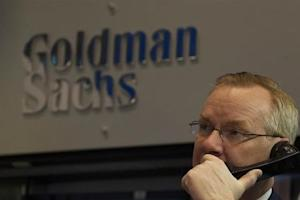 Goldman Sachs trader Dennis Maguire works in his company's stall on the floor of the New York Stock Exchange
