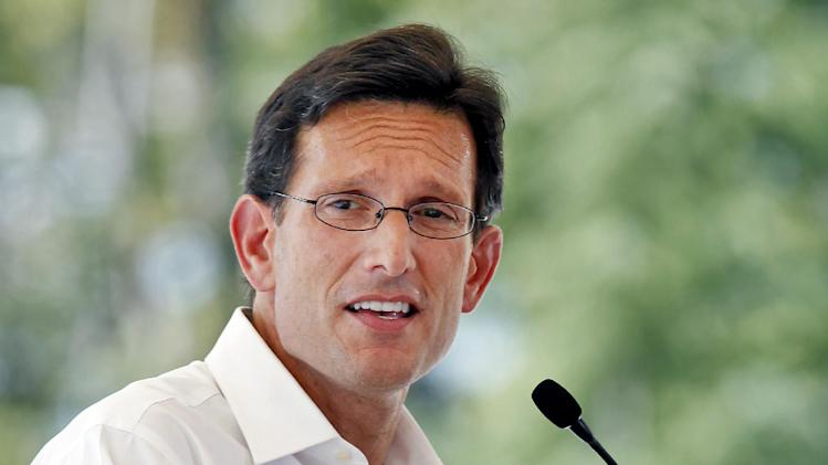 "House Majority Leader Eric Cantor speaks during a jobs event at Titan America, Friday, Sept. 9, 2011 in Henrico County Va. In full re-election mode, President Barack Obama began a public relations blitz in Republican House Majority Leader Eric Cantor's backyard, prodding Congress to adopt his $447 billion jobs package. Cantor, Obama's chief congressional critic, held his own campaign-style event and said a White House ""all-or-nothing"" ultimatum won't work.(AP Photo/Richmond Times-Dispatch, Mark Gormus)"