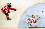 Canada's Ryan Nugent-Hopkins shoots against Belarus' goalie Dmitri Milchakov during a preliminary round game of the IIHF International Ice Hockey World Championship in Helsinki. Canada won 5-1