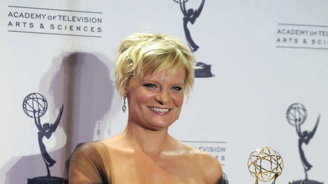 "Martha Plimpton poses backstage with her award for outstanding guest actress in a drama series for playing Patti Nyholm on ""The Good Wife"" at the 2012 Creative Arts Emmys at the Nokia Theatre on Saturday, Sept. 15, 2012, in Los Angeles. (Photo by Chris Pizzello/Invision/AP)"