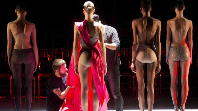 Models are dressed on stage to present the creation from the Fause Haten Summer collection during the Sao Paulo Fashion Week in Sao Paulo, Brazil, Wednesday, April 2, 2014. (AP Photo/Andre Penner)