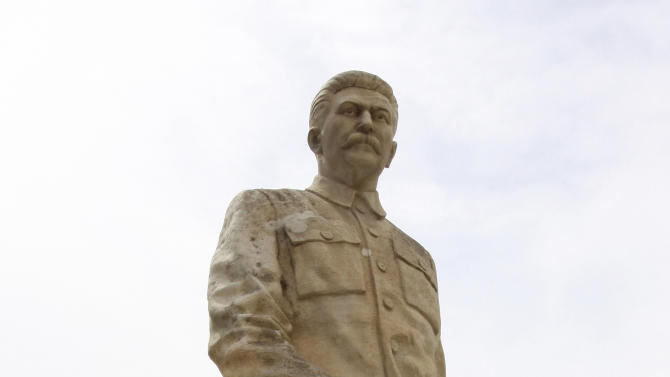 A statue of Soviet dictator Josef Stalin is seen at the entrance to a museum dedicated to him in the town of Gori, some 80 kilometers (50 miles) west of the Georgian capital Tbilisi, Monday, April 9, 2012. A museum that has honored Josef Stalin in Georgia since 1937 is being remodeled to exhibit the atrocities that were committed during the Soviet dictator's rule. (AP Photo/Shakh Aivazov)