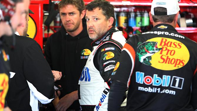 Driver Tony Stewart talks with his crew after  practice for Sunday's Sprint Cup Series  at New Hampshire Motor Speedway, Saturday, July 12, 2014 in Loudon, NH