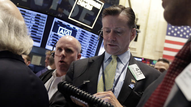 Trader Neil Catania, right, works on the floor of the New York Stock Exchange, Friday, May 23, 2014. Stocks inched higher early Friday in quiet trading ahead of the Memorial Day weekend. (AP Photo/Richard Drew)