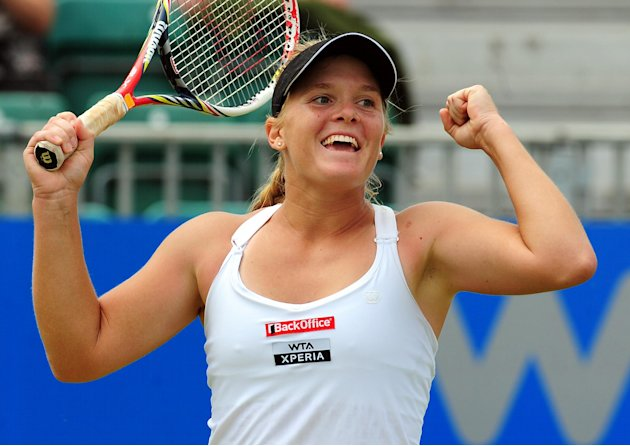 USA's Melanie Oudin celebrates defeating Serbia's Jelena Jankovic 6-4 6-2 in the final of the AEGON Championships at Edgbaston Priory Club, Birmingham England  Monday June 18, 2012. (AP Photo/ Rui Vie