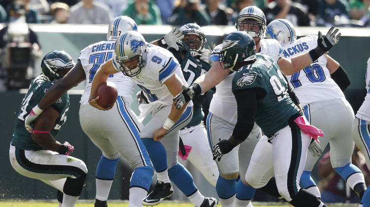 Detroit Lions quarterback Matthew Stafford (9) scrambles against the Philadelphia Eagles during the first half an NFL football game, Sunday, Oct. 14, 2012, in Philadelphia. (AP Photo/Mel Evans)