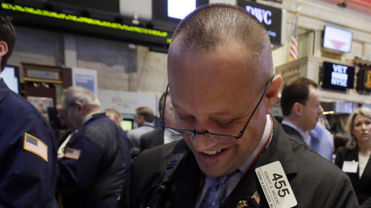 Trader Robert Arciero works on the floor of the New York Stock Exchange Tuesday, March 12, 2013.  Stocks are edging lower on Wall Street in early trading following a seven-day rally. (AP Photo/Richard Drew)