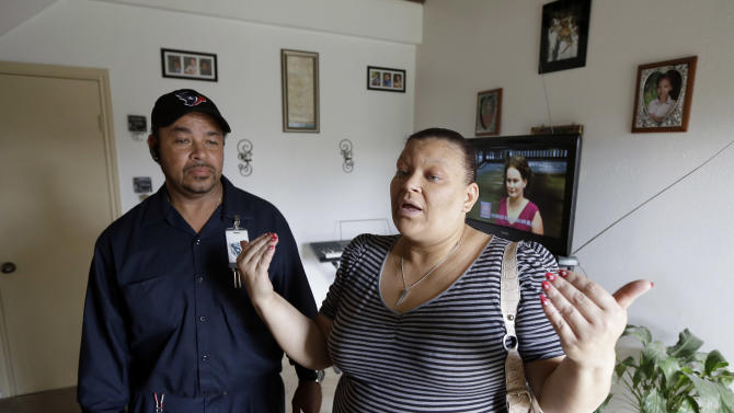 Junita and Joseph Auguillard talk about having Miguel Morin in their home just before his arrival Friday, Jan. 11, 2013, in Channelview, Texas. A judge in Houston ruled Wednesday that 8-year-old Miguel Morin, a Texas boy who was kidnapped as a baby, should be removed from foster care and given to the Aguillard's, the couple caring for his four siblings. The boy has been in foster care since authorities found him in March living in East Texas with his former baby sitter. The boy's former baby sitter and her mother are charged with kidnapping. (AP Photo/David J. Phillip)