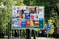 Election posters are displayed on a billboard in the Hague. The Netherlands began voting in crunch polls Wednesday seen as a barometer of anti-European sentiment after a riveting campaign that has shaped into a tight race between two pro-Europe parties