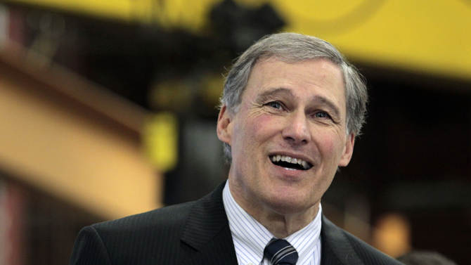 In this photo taken Feb. 6, 2102, Rep. Jay Inslee, D-Wash., speaks at a manufacturing facility in Seattle, Wash. Democratic officials said Saturday, March 10, 2012, that eight-term veteran Inslee intends to resign from Congress to focus full time on running for governor of Washington state this fall. Washington's Democratic governor, Christine Gregoire is retiring at the end of her term, and Inslee has long been rumored as a Democratic contender to replace her. (AP Photo/Elaine Thompson, File)