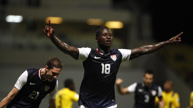 US Eddie Johnson, center, celebrates after scoring against Antigua and Barbuda during a 2014 World Cup qualifying soccer match in St. John, Antigua and Barbuda, Friday, Oct. 12, 2012. (AP Photo/Ricardo Arduengo)