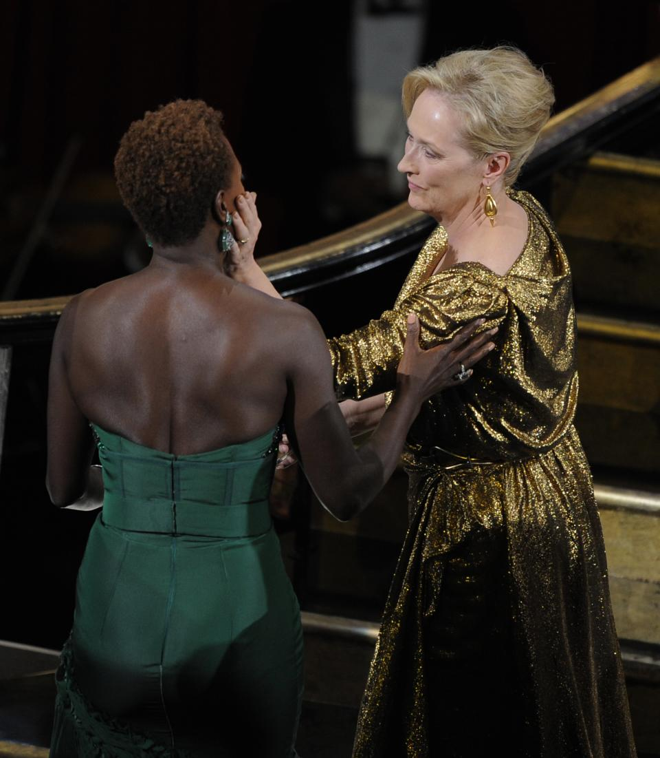 "Meryl Streep is congratulated by Violet Davis before accepting the Oscar for best actress in a leading role for ""The Iron Lady"" during the 84th Academy Awards on Sunday, Feb. 26, 2012, in the Hollywood section of Los Angeles. (AP Photo/Mark J. Terrill)"